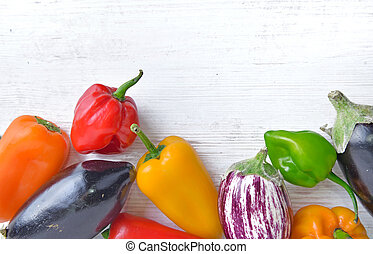 collection of colorful vegetables as peppers and eggplants on a white table with copy space