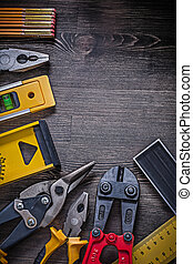 Collection of construction items on wooden background...