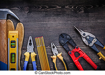Collection of construction tools on wood board