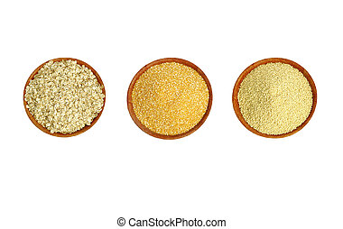 A set of three types of cereals on a brown plate (millet, maize and cereal).