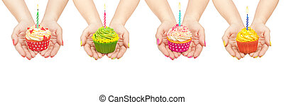 collection of cupcakes in hand isolated on white background