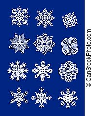 Collection of cut out paper snowflakes isolated on blue background