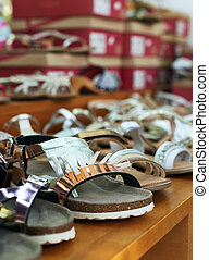 Collection of different kids shoes in shop.