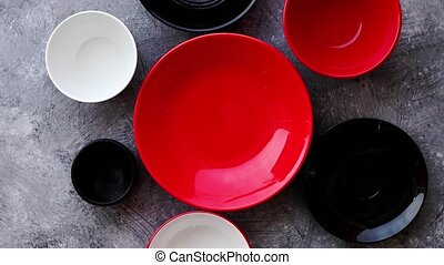 Collection of empty colorful decorative ceramic bowls on...