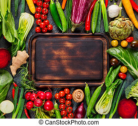 Collection of fresh vegetables with breadboard - Collection...
