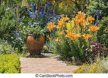 collection of garden flowers in bloom in english garden