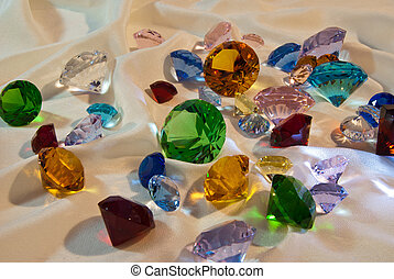 Collection of glass gems with green in center