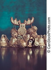 Collection of golden Christmas ball and bell ornaments with ...
