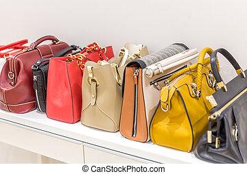 Collection of handbags standing in a row