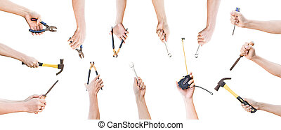 Collection of hands holding mechanic tools isolated on white