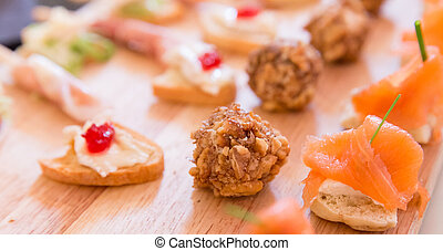 Collection of Hors D'oeuvres on a wooden platter