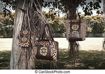 collection of indian design bags hang on tree