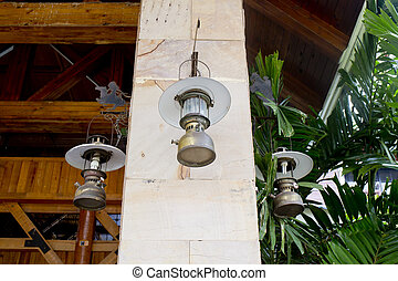 Collection of Lantern hanging on hook on marble pillar