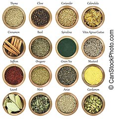 Collection of metal bowls full of herbs and spices