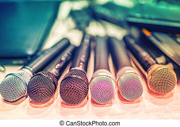 collection of microphones and dj equipement at a concert, in...