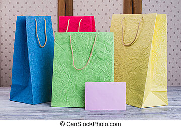 Collection of paper shopping bags.