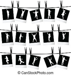 Collection of photo frames hanging on rope with children silhouettes