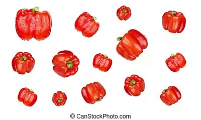 Collection of organic red bell peppers with green stems covered with clear water drops turning around slowly on white background