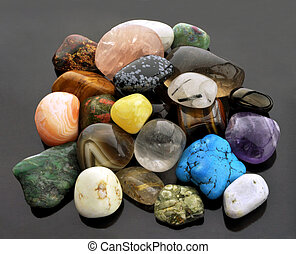 Various semi-precious gemstones, isolated on neutral grey background