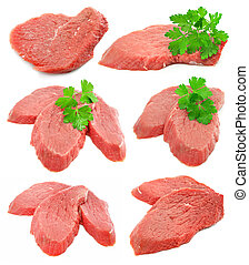 collection of sliced meat with green parsley leafs