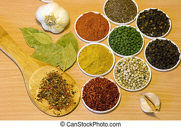 Collection of spices on wooden board