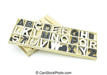 collection of uppercase typeface made from wood isolated white background