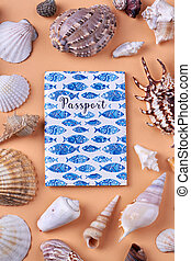 Collection of various seashells and passport.