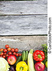 Collection of various vegetables and fruits on rustic wooden background. Copy space. Top view. From above.