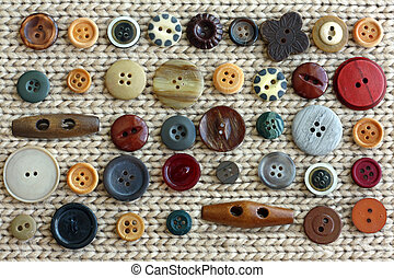 Collection of Vintage Buttons Scattered on Fabric Background