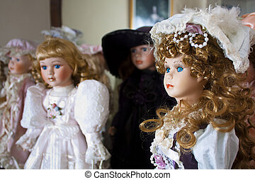 Collection of vintage porcelain dolls in Victoriian and Edwardian dress