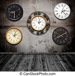 collection of wall clock against an wall in old room