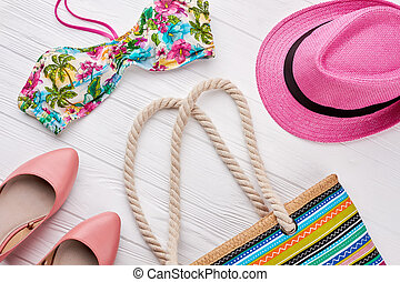Collection of women beach accessories.