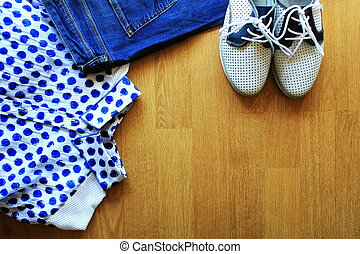Collection of women's clothes. Jeans, shoes, bluose. Top view
