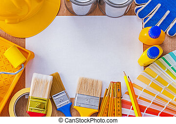 Collection  repair and paint tools on clean sheet of paper con