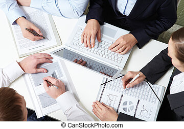 Collective work - Place of work of four business people