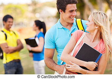 college couple embracing outdoors