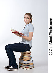 college female student sitting on stack books