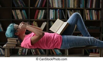 College female student studying hard in library