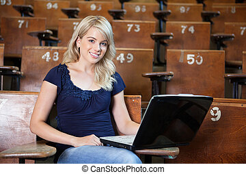 College girl using laptop