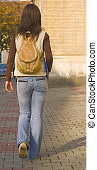 College girl with backpack walking near the university ...