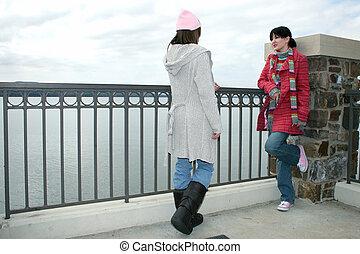 College Girls Talking at the Lake