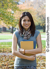 College student - A beautiful college student carrying books...