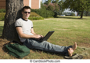 College Student - College student on campus with laptop.