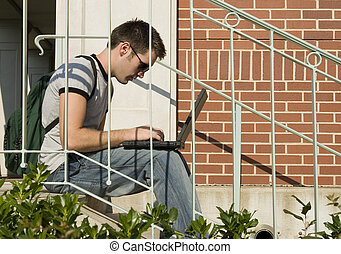 College Student - College student on steps with laptop.