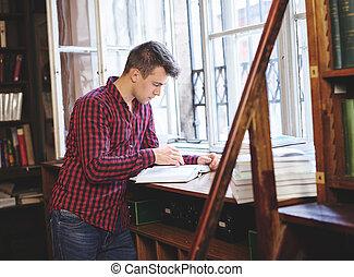 college student, het boek van de lezing, in, universiteit, bibliotheek