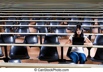 college student in lecture room alone