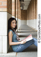College student - A beautiful college student studying on...