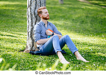 College student studying in park