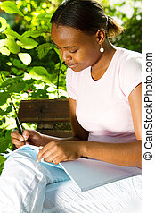 college student studying - beautiful young african american...