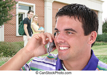 College Student Talking On Cell Phone On College Campus